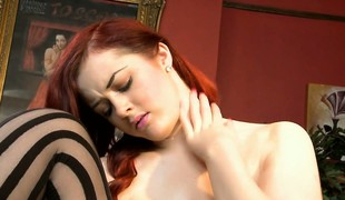 Naughty in along to assignation as a blue redhead secretary sinks a dildo deep