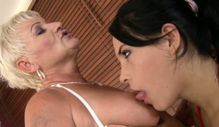 Aged and juvenile of a female lesbian babes take a seethe bathroom and lick some bald pussy