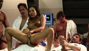 A group of men stand around this Oriental chick, fucking her hard