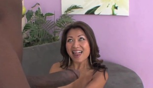 Tanned oriental milf Jackie Lin takes on dark cannon
