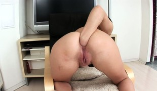 Babe copulates herself with a gigantic dildo and then fists her ass