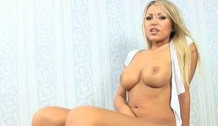 A blonde is masturbating in front of the camera in an delightsome fashion
