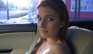 Redhead on every side massive tits flashing in a strangers car