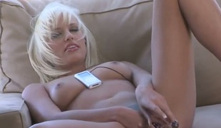 Jodie Starr poses seductively before masturbating