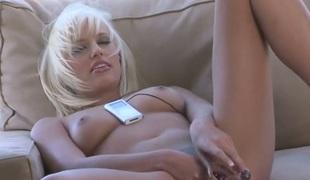 Jodie Starr poses seductively before masturbating