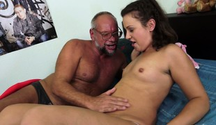 Little brunette makes it with an old guy and drinks his pee
